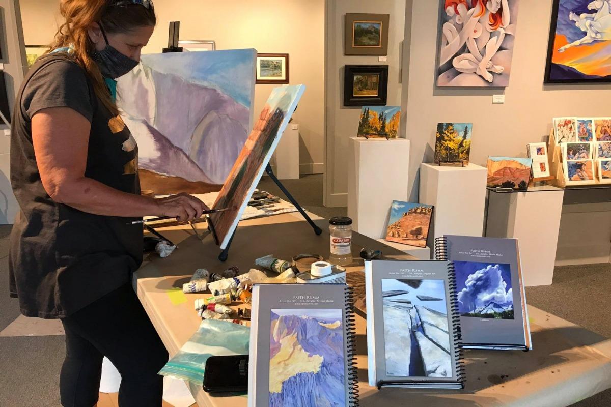 Artist Faith Rumm painting at the Yosemite Gateway Art Center Gallery