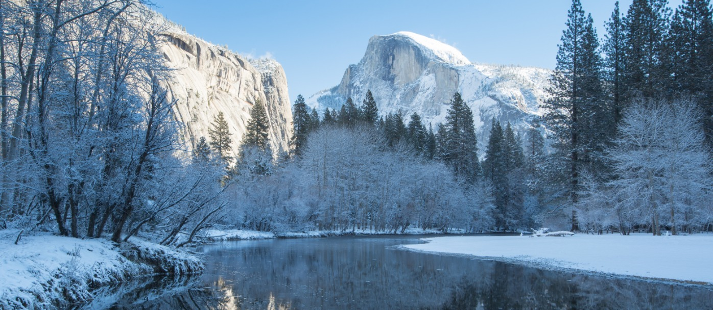 Winter reflections of Half Dome on the Merced in Yosemite