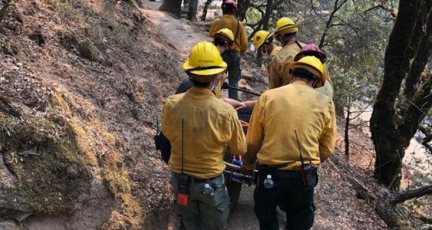 USFS carry a 29-year-old woman along the trail near Willow Creek in Bass Lake.