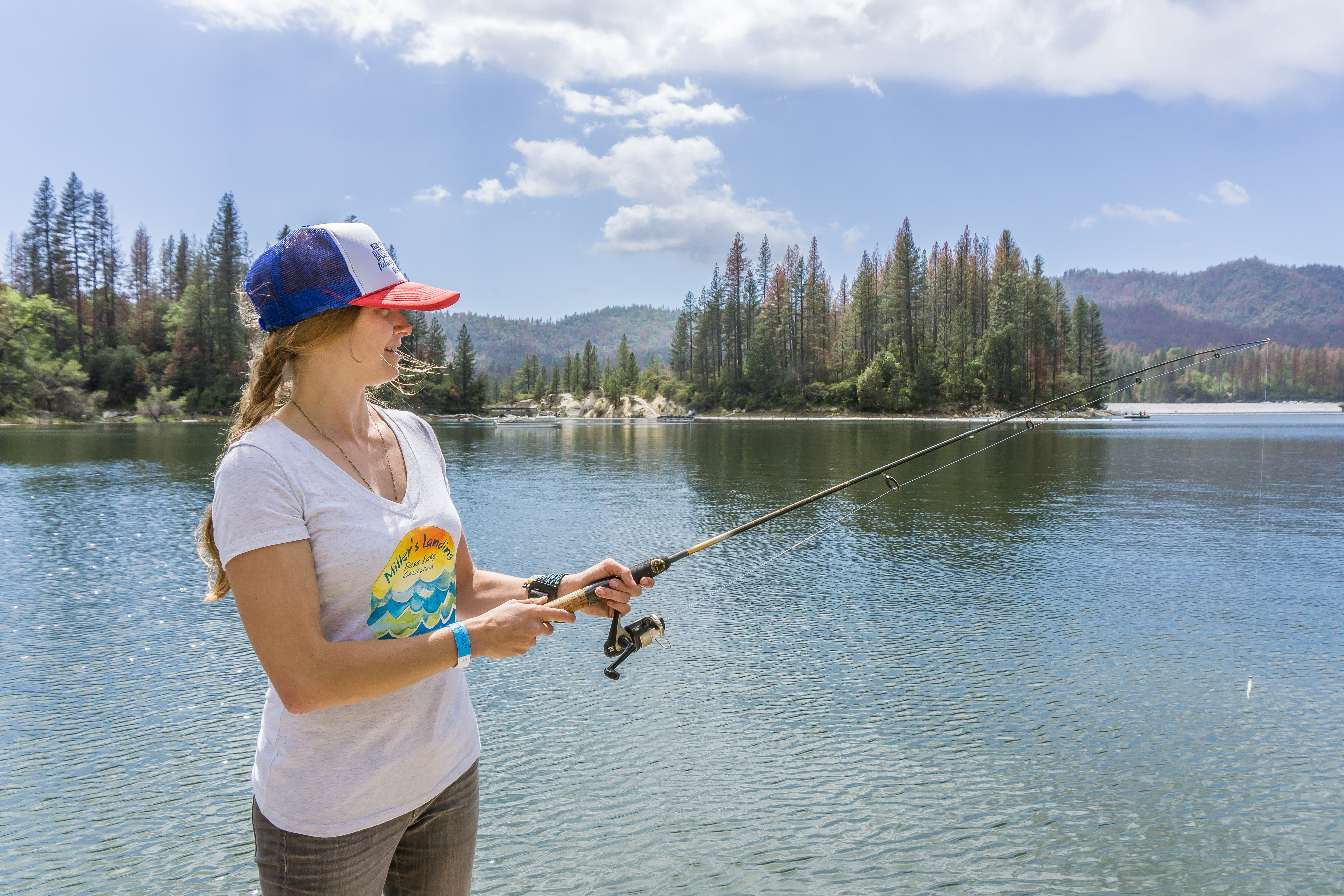 Fishing on the shores of  Bass Lake during the annual Fishing Derby